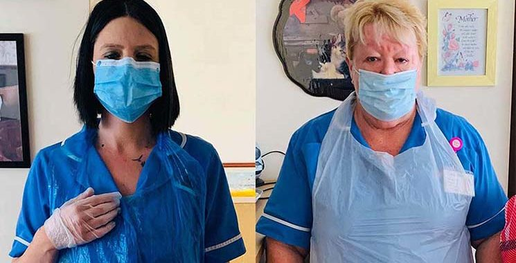 Care workers wearing donated PPE